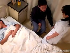 Mature Japanese nurse enjoys a MMF threesome in a hospital ward