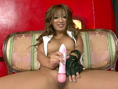 Smiling bitch with heavy makeup Hina Maeda uses sex toys to tease her cunt