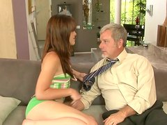 Passionate bootylicious brunette sucks a stiff dick of the lucky old man