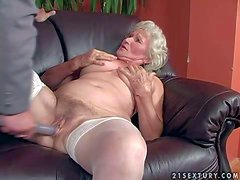 Short haired blonde granny Norma with hanging knockers in white