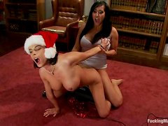 Two sexy Santa girls play with fucking machines in the living room