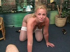 Tanned blondie Stella is pro in giving a blowjob and handjob for sperm