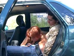 Messy red-haired hoe gives a head to aroused wanker in a car
