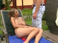 Full bosomed blonde temptress gives her boyfriend a nice blowjob