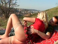 Wondrous blondie Sandra provides a dude with a blowjob on the top of the hill