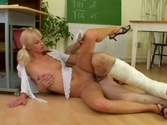 Ugly blond head Zdenka rides the teacher's dick right on the floor