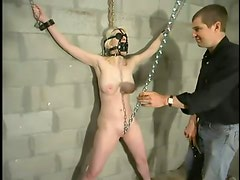 Blonde Hangs Upside Down by Ropes in Extreme Bondage Video