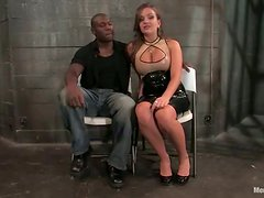 Busty girl ties up Black guy and toys him with a strap-on