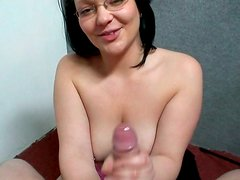 Brunette in glasses  jerks off meaty dick