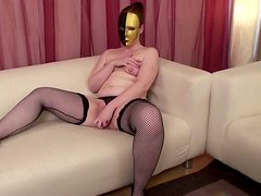Chubby Claudia rubs her cunt wearing mask