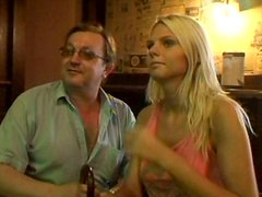 Skanky blond amateur gives a head to aroused daddy sitting at table in bar