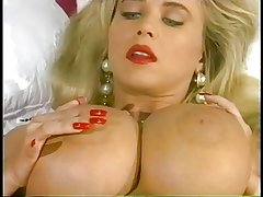 Blonde With Huge Tits Rubs Lotion On Her Body