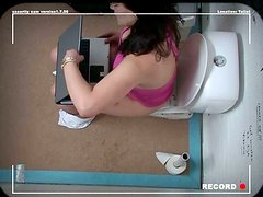 Brunette BBW sits on toilet bowl while sucking strain dick through glory hole