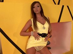Green eyed enchantress plays with her yellow dildo