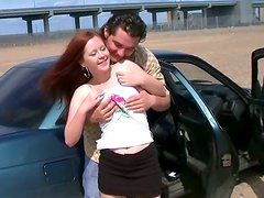 Young red-haired slut gives head in the car