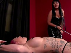 Wicked brunette mistress snows no mercy punishing her slave