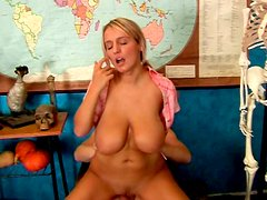 Hussy blone massages dick with her big boobs
