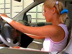 Pretty and playful blonde cutie was driving her car when suddenly she felt desire