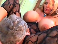 Busty blonde gives a hot titjob on the cam
