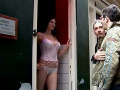 Curvy appetizing slut meets two clients for teasing them in the brothel