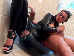 Ripped leather catsuit on a cock riding slut