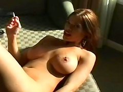 Hot blonde is poking her puss with a cigarette
