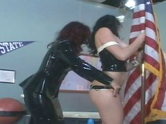 Horny latex queen Krissy teaches busty brunette in corset what BDSM is