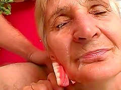 Mature granny fuck in her shaved puss