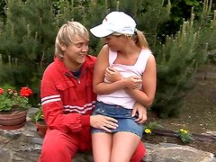 Sporty slim and tanned blondie in cap Kate is ready to suck a dick outdoors