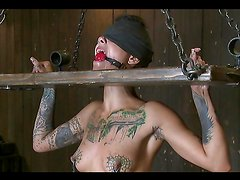 Tattooed chick gets slapped in the face and abused in bdsm video