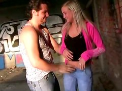 Big breasted blonde temptress gives head in abandoned building