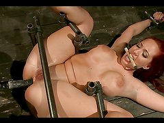 Big titty redhead gets abused in bondage video