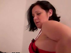 Older experienced woman is stripping