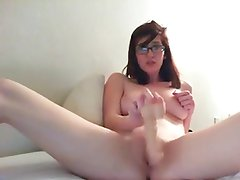 Nerd talking dirty and riding a dildo