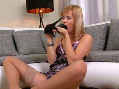 Perverted blond girl is poking her twat with high heel shoes