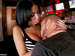 Guy gives the barmaid a large piece of meat
