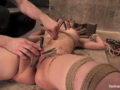 Pretty brunette gets her pussy toyed and clothespinned