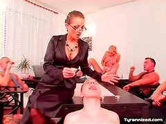 Corporate board meeting turns into femdom play
