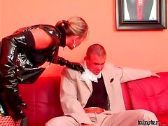 Full latex outfit on sexy mistress dominating him
