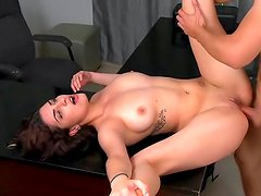 Hot brunette is giving a blowjob in the office
