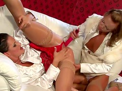 Two rapacious sluts poke their cunts with vibrators in lesbian sex video