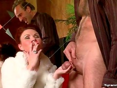 Smoking mistress plays rough with his balls