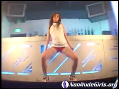 Sexy Asian dances in the bar and looks hot