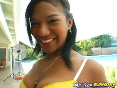 Ebony teen Emy Reyes smiles with cum in her mouth
