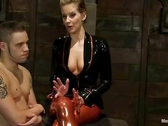 Wolf Hudson gets bounded and covered with hot wax in femdom vid