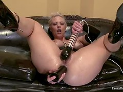 Holly Heart moans loudly while fucking her ass with a big dildo