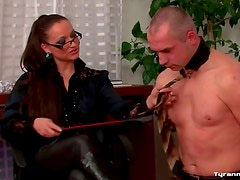 Boss in the office dominates him in leather