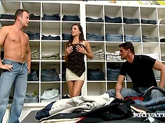Sexy brunette Vanessa May satisfies two men in a shop