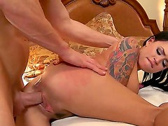 Tattooed black haired curvy bitch Eva Angelina with big fake tits and long red nails gets
