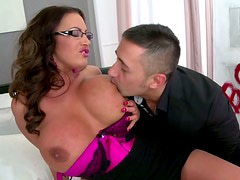 Nasty busty filth in glasses provides a lucky bastard with a titfuck